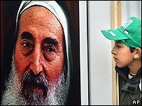 A young Palestinian boy looks at a picture of former Hamas spiritual leader Sheik Ahmed Yassin.