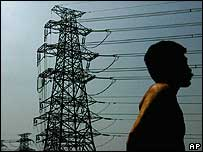 A Chinese man looks at electricity pylons outside his house in Beijing.