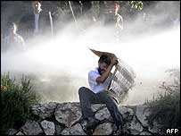 Protester sprayed with water cannon