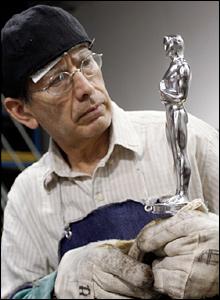 Examining polished Oscar statuette