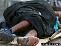 A homeless Israeli man sleeps on the street in downtown Tel Aviv.