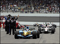 Fernando Alonso's Renault leads the other Michelin teams into the pits at Indianapolis