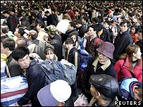 Chinese travellers wait for the train from Shanghai to Chengdu at Shanghai railway station in Shanghai
