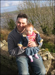Adam Wilcox with daughter Eliza at Llanstephan Castle, Carmarthen by Justine Wilcox