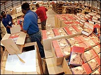 Amazon.co.uk staff preparing the previous Potter book for delivery