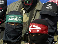Palestinian militants hold a press conference in Gaza