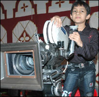 Master Kishan with a camera