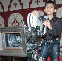 Master Kishan with a camera