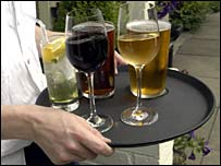 Man carrying tray with wine glasses