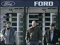 Ford employees leave the Wixom Assembly Plant, in Wixom, Michigan, which will close under the company's restructuring plans