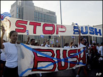 Cuban marchers carry anti-Bush signs