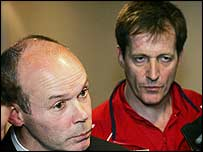 Lions coach Sir Clive Woodward (left) addresses the media as Alastair Campbell looks on