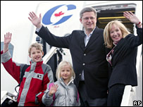 Prime Minister Harper and his family on board a plane in Calgary