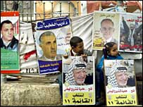 Palestinian children hold election posters in the West Bank city of Ramallah