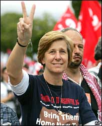 US peace activist Cindy Sheehan gestures to the crowd in Caracas