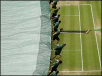 The covers are pulled across Wimbledon's Centre Court