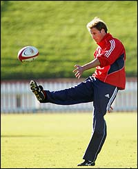 Prince William kicks the ball during the training session