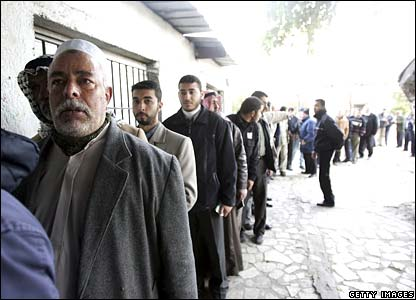 Palestinian men queuing outside polling station