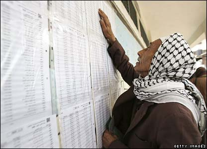 A man looks for his name on the electoral list