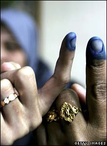 Inked fingers show voters have cast their ballot
