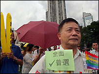 A man takes part in a pro-democracy march on a Hong Kong downtown street Friday, July 1, 2005.