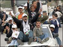 Young supporters of Fatah riding on a vehicle in Ramallah