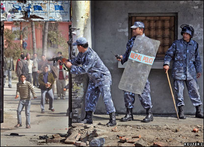 A Nepalese police officer fires a teargas shell