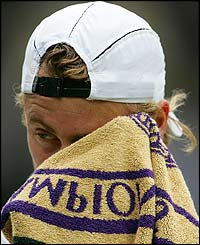 Lleyton Hewitt mops his brow