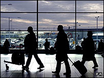 Passengers checking in at an airport
