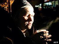 A homeless woman drinks tea distributed by a charity in Moscow 