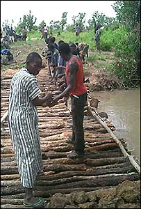 Trekkers building a bridge in Sudan