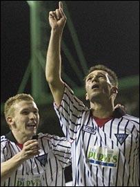 Craig Wilson celebrates with scorer Darren  Young