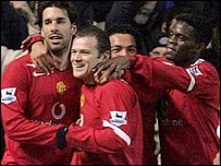 Ruud van Nistelrooy (left), Wayne Rooney (centre) and Louis Saha celebrate against Blackburn