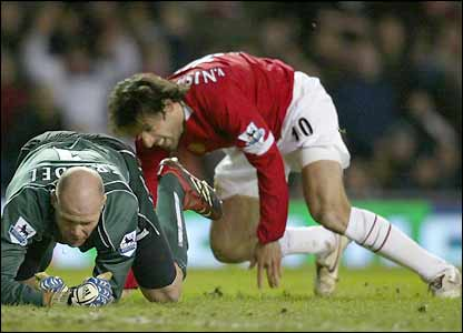 Ruud van Nistelrooy beats keeper Brad Friedel to score