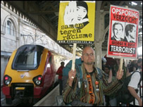 Protester stepping off a train in Edinburgh / AP