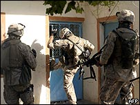 US Marines carrying out a house raid during Operation Spear, targeting insurgents in Anbar province