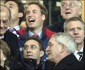 Prince William enjoys the action from the stands