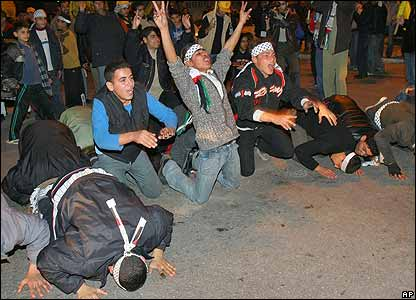 Fatah supporters praying and celebrating the exit polls