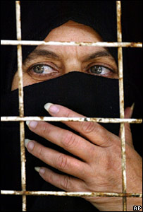 An Iraqi woman prisoner at Abu Ghraib in 2004