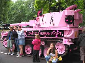 Pink tank with Love is a Human Right slogan