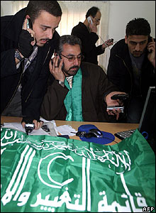 Hamas supporters watch a computer screen at the party's office in the West Bank city of Jenin
