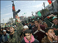 Supporters of the radical Islamist movement Hamas celebrate the group's apparent victory in the Palestinian parliamentary elections