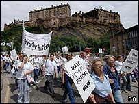 Marchers pass below Edinburgh Castle in the Make Poverty History March