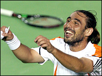 Marcos Baghdatis celebrates his win over David Nalbandian