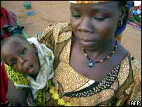 A woman with her child at a feeding station in Niger
