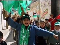 Palestinian boys waving Hamas flags in Gaza City