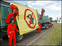 Activists chain themselves to a lorry carrying supplies to the mills on 19 January