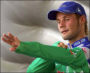 Belgium's Tom Boonen puts on the green jersey