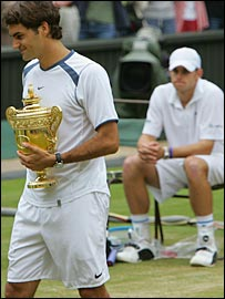 Roger Federer (left) leaves Andy Roddick trailing in his wake