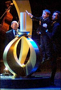 Samuel Pfister, 7, lights the Memorial flame at the Holocaust Memorial Day event at the Wales Millenium Centre, Cardiff, 26 January 2006